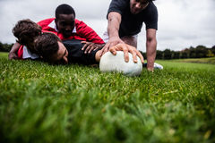 Rugby players tackling during game. At the park Stock Photography