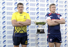 Rugby players with trophy Stock Images