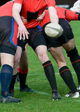 Rugby scrum. Pass the balloon at rugby sport Royalty Free Stock Image