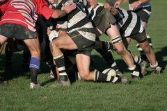 Rugby Scrum. Shot of a rugby scrum at ground level with the ball coming back. Logos on boots etc. removed royalty free stock photo