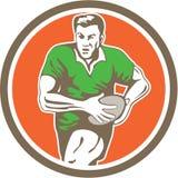 Rugby-Spieler-laufender Ball-Kreis Retro- Stockbild