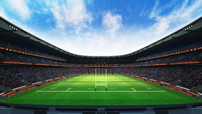Rugby stadium with fans and grass at daylight Royalty Free Stock Images