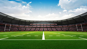 Rugby stadium with fans and green grass at daylight Stock Images