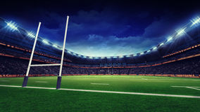 Rugby stadium with green grass playground and goal Royalty Free Stock Photo