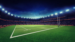 Rugby stadium with green grass playground Stock Images