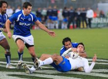 Rugby test match Italy vs Samoa; tackle Stock Photos