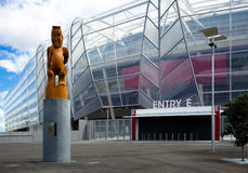 Rugby World Cup 2011 Main Venue. A wood carving of the Maori God Rongomatae stands in front of the just-opened Eden Park Stadium, Auckland, New Zealand, the main Stock Photos