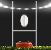 Rugbybollen stöd till stolparna på ett rugbyfält Arkivbild