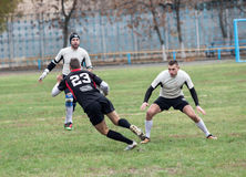 Rugbyspelare i uppgift Arkivfoto