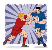 Rugbyspieler, der angepackt wird Stockbild