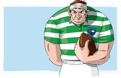 Rugbyspieler mit Kugel Stockbild