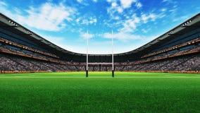 Rugbystadionbyggnad med grönt gräs på dagsljus Royaltyfri Foto