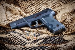 Ruger P85 Handgun With 9MM Ammunition Royalty Free Stock Image