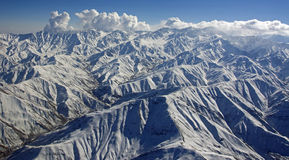 Rugged Afghanistan Mountain Range. A majestic snow covered mountain range found to the east of Kabul, Afghanistan which sticks up far above all the all the Royalty Free Stock Images