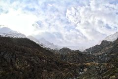 Rugged Alps with Clouds Royalty Free Stock Photography