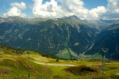 Summer panoramic Austrian mountain valley scene. Rugged Austrian Alps mountain range with valley and summer sky in Bludenz Austria royalty free stock images