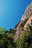 Rugged Mountain Rock Cliff, Kalavryta, Peloponnese, Greece. A rugged bare rocky cliff in Peloponnese mountains, near Kalavryta, with clear blue sky, Greece royalty free stock image