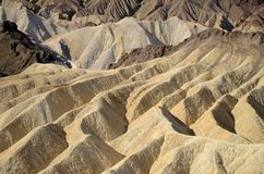 Barren, colorful desert landscape of sharp, steep ridges, mountains, gullies, and canyons stock photography