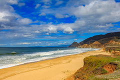 Rugged beach in Pacifica California on a cloudy day. Rugged Northern Californa beach in Pacifica near San Francisco on a cloudy day, with a beam of sunlight on royalty free stock image