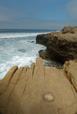 Rugged bluff on open california ocean Stock Photos