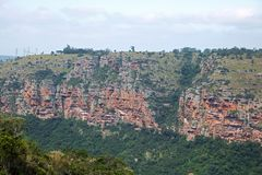 RUGGED CLIFFS ON FAR SIDE OF GORGE CANYON. View of cliffs and vegetation on far side of Oribi Gorge canyon wall in Kwazulu Natal Stock Images
