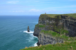Rugged Cliffs of Moher with Sea Stack. Beautiful scenic Cliffs of Moher in County Clare Ireland Royalty Free Stock Photo