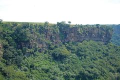RUGGED CLIFFS OF ORIBI GORGE. View of cliffs and vegetation on far side of Oribi Gorge canyon wall in Kwazulu Natal Stock Images