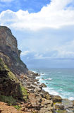Rugged cliffs and rocky shore on NSW coast Royalty Free Stock Photos