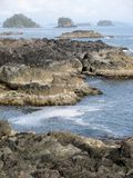 Rugged cliffs and shoreline. The Wild Pacific Trail, Ucluelet, BC, Canada Royalty Free Stock Photography