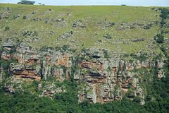 RUGGED CLIFFS AND VEGETATION ON FAR SIDE OF ORIBI GORGE CANYON. View of cliffs and vegetation on far side of Oribi Gorge canyon wall in Kwazulu Natal Stock Image