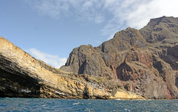 Rugged Cliffs on a Volcanic Island Stock Image