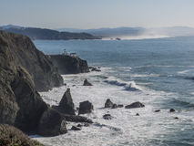 Rugged coast line on sunny day Royalty Free Stock Images
