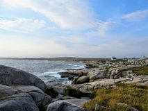 The rugged coast off of Peggys Peggys Cove Lighthouse, an active lighthouse and an iconic Canadian image, in Nova Scotia, Canada. stock photography