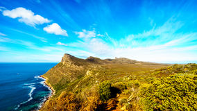 The rugged coast and wind swept peaks near Cape Point. On the Cape Peninsula in South Africa under blue sky Stock Photos