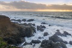 Rugged Coastline with dramatic sky in distance. Shot near Point Montara in Montara, San Mateo County, California, USA royalty free stock photo