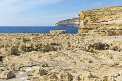 Rugged coastline of island of Gozo. Gozo is a small island of the Maltese archipelago in the Mediterranean Sea.  Rugged coastline delineated by sheer limestone Royalty Free Stock Photo