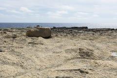 Rugged coastline of island of Gozo. Gozo is a small island of the Maltese archipelago in the Mediterranean Sea.  Rugged coastline delineated by sheer limestone Stock Photos