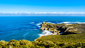 Rugged coastline and steep cliffs of Cape of Good Hope on the Atlantic Ocean. Side of the Cape Peninsula in South Africa royalty free stock photo