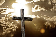Rugged Cross, Bright Sun and Clouds (sepia) Stock Photos
