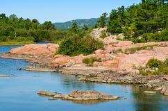 Rugged Georgian Bay coastline. Pink granite rocks on Georgian Bay shoreline Stock Photography