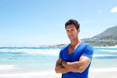 Rugged good looking man standing at the beach Royalty Free Stock Image