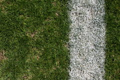 Rugged grass and yardline of a football field Stock Photo