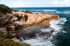 Rugged Hawaii Coast. A wave breaks against a cliff on the rugged Hawaiin coast Stock Photography