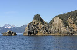 Rugged Islands on Remote Coast. In Kenai Fjords National Park in Alaska royalty free stock images