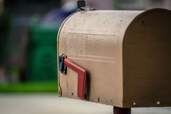 Rugged Mailbox. Rugged tan mailbox facing away Royalty Free Stock Images