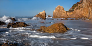 Rugged Malibu Beach. This is an image taken early in the morning of the surf pounding against a secluded and rugged beach in Malibu, California Royalty Free Stock Image