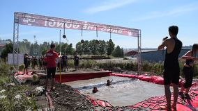Rugged Maniac Competition. Participants compete in a race of endurance and physical fitness at the Rugged Maniac Competition stock video footage