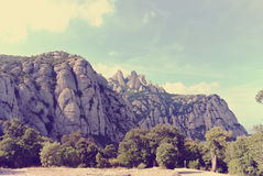 Rugged mountain landscape on a sunny day; filtered, retro style Royalty Free Stock Images