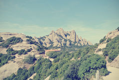 Rugged mountain landscape on a sunny day; filtered, retro style Royalty Free Stock Photography