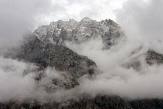 Rugged Mountain Peak Shrouded In Storm Clouds Stock Images
